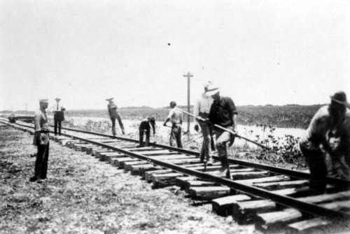 Laying Track Outside Homestead