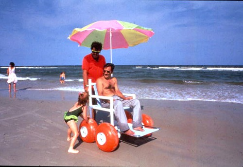 Tourist In A Beach Wheelchair