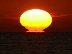 Blazing sun dips it's head into the Atlantic Ocean off Key West Florida