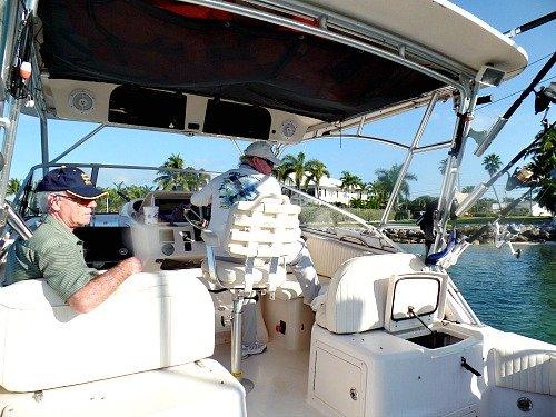 Captain Danny Aldridge at the Helm of the Grady 33 foot With Dan Sheehan As Passenger