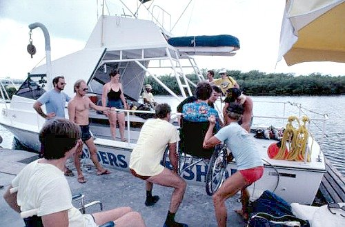 Disabled Florida Keys Diver Being Assisted Onto A Boat