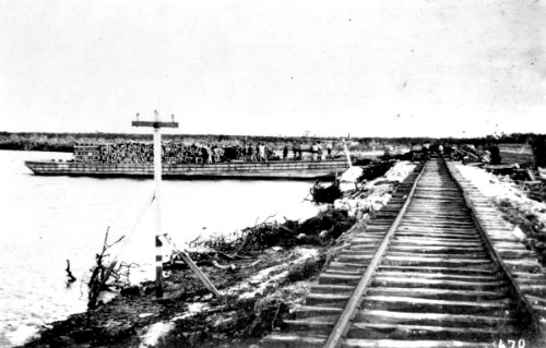 Railroad Ties Being Unloaded from a Barge